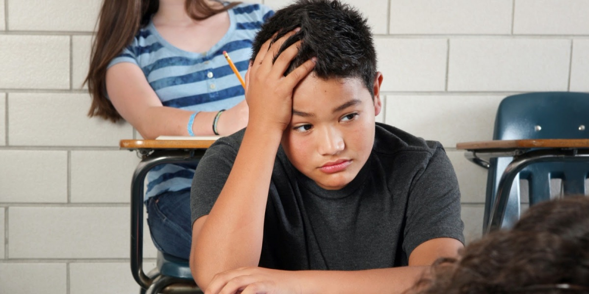 Middle school boy in class.